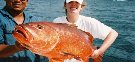 girl with Cubera Snapper on a boat in Costa Rica