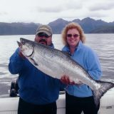 Lisa Montgomery and friend, holding their caught fish up for demonstration purposes