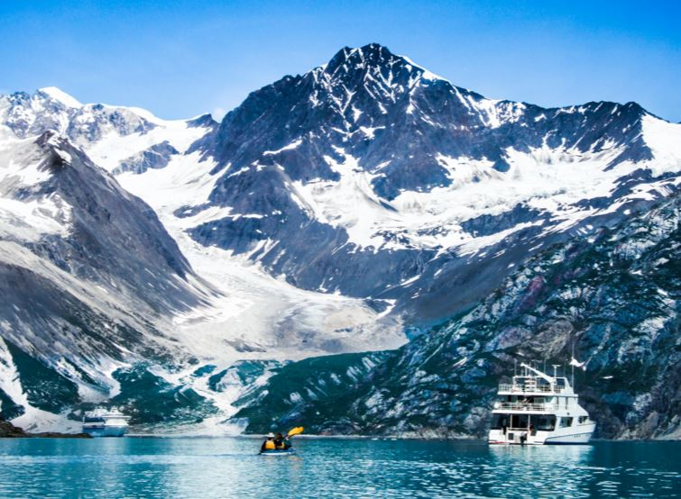 picture of boats in the water in front of mountains with glaciers at Glacier Bay Alaska