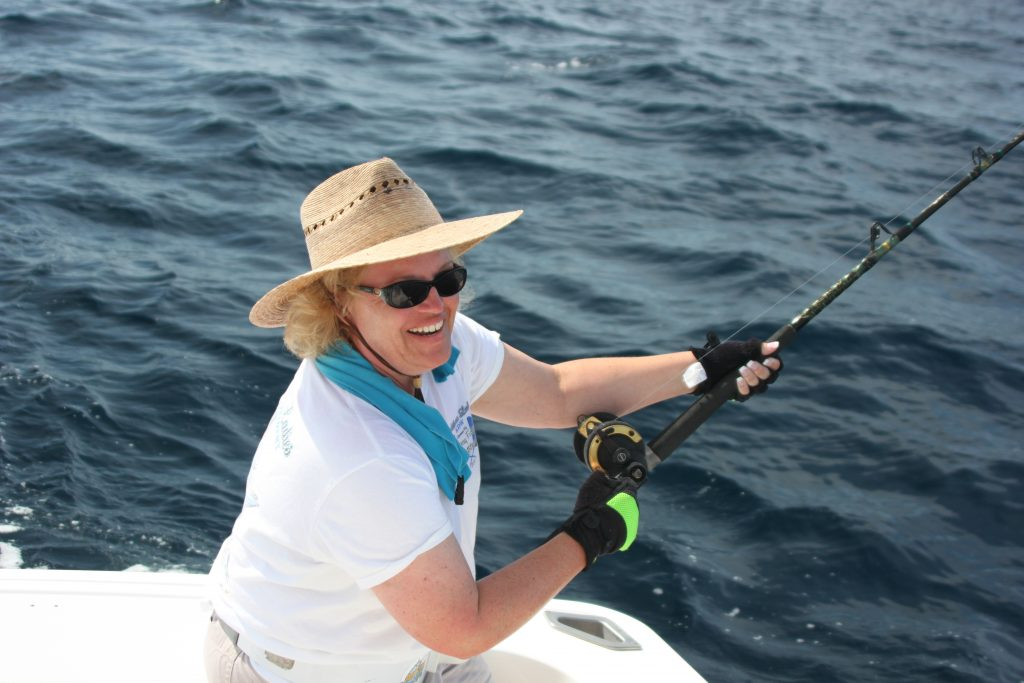 Lisa Travel Expert Fishing on Back of Boat